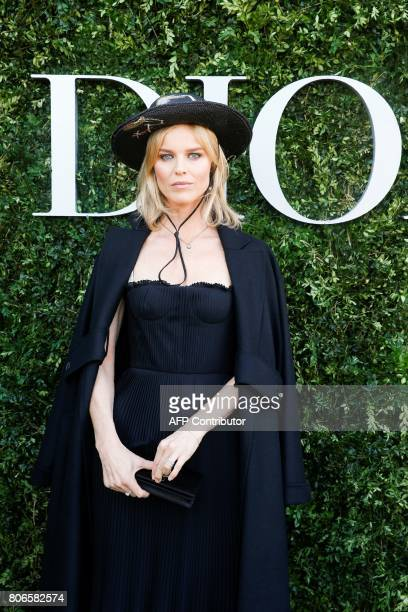 Czech model Eva Herzigova poses as she arrives for the opening of the Dior exhibition that celebrates the seventieth anniversary of the Christian...