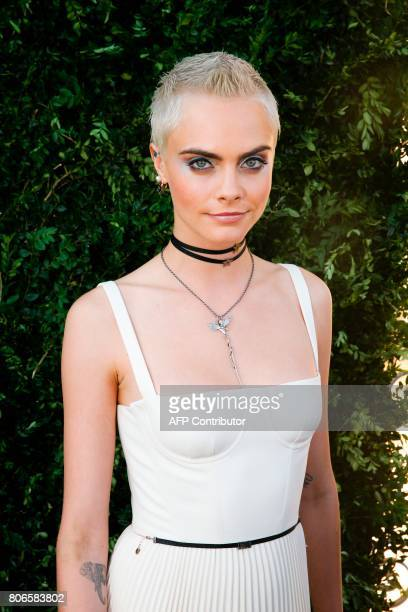 British model and actress Cara Delevingne poses while arriving for the opening of the Dior exhibition that celebrates the seventieth anniversary of...