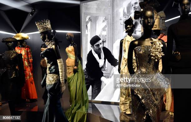 Dresses by British fashion designer John Galliano are pictured during the Dior exhibition that celebrates the seventieth anniversary of the Christian...
