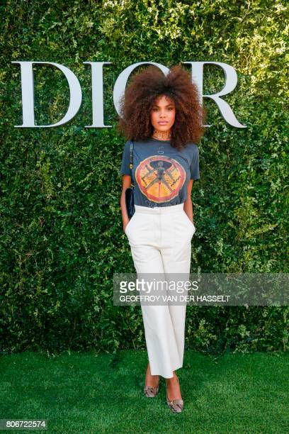Italian model Tina Kunakey poses as she arrives for the opening of the Dior exhibition that celebrates the seventieth anniversary of the Christian...
