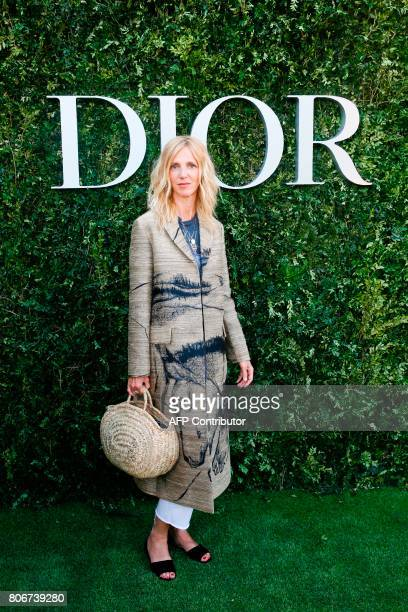 French actress Sandrine Kiberlain poses as she arrives for the opening of the Dior exhibition that celebrates the seventieth anniversary of the...