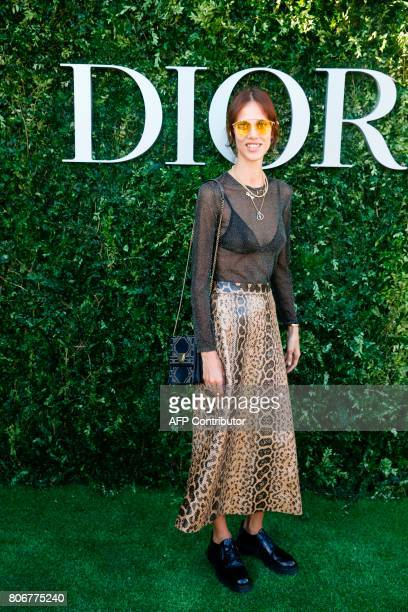 French actress and model Aymeline Valade poses as she arrives for the opening of the Dior exhibition that celebrates the seventieth anniversary of...
