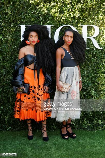 US twin sisters TK Wonder and Cipriana Quann pose as they arrive for the opening of the Dior exhibition that celebrates the seventieth anniversary of...