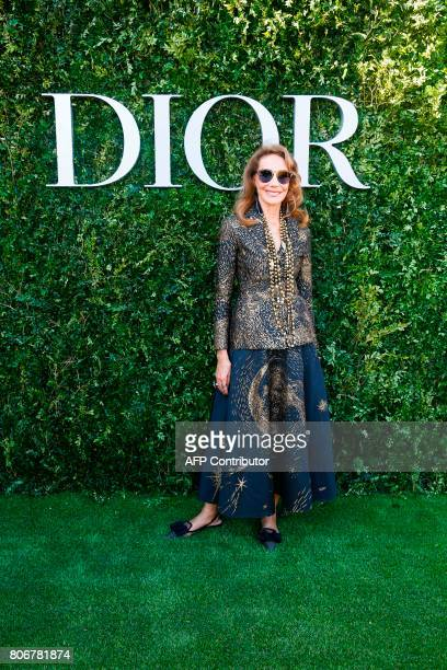 US actress Marisa Berenson poses as she arrives for the opening of the Dior exhibition that celebrates the seventieth anniversary of the Christian...