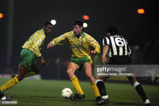 ATTACKS THE NEACASTLE DEFENCDE DURING THE GAME AT CARROW ROAD