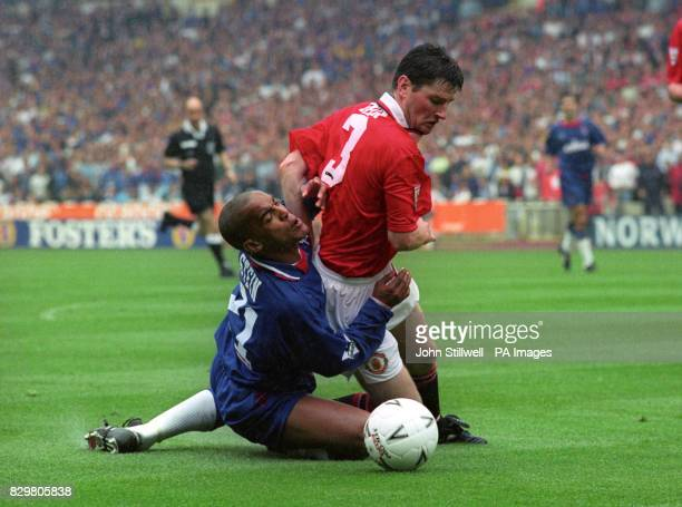 S MARK STEIN SKIDS ON THE SLIPPERY WEMBLEY TURF AS MANCHESTER UNITED'S DENIS IRWIN COLLECTS THE BALL DURING THE FA CUP FINAL THE MATCH WAS WON BY...
