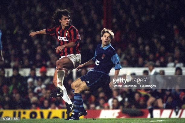 S PAUL MERSON BACK IN THE ACTION AGAINST AC MILAN'S PAOLO MALDINI DURING THE SUPERCUP MATCH AT HIGHBURY