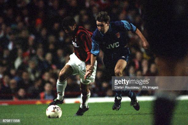 S PAUL MERSON BACK IN THE ACTION AGAINST MAURO TASSOTTI OF AC MILAN DURING THE SUPERCUP MATCH AT HIGHBURY