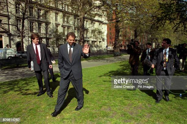 ARE FOLLOWED BY THE MEDIA AS HE WALKS THROUGH WESTMINSTER IN LONDON WHERE HE GAVE A NEWS CONFERENCE CONCERNING RECENT BOMB ALERTS
