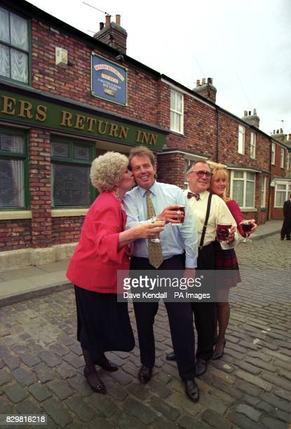 AND RAQUEL WATTS FOR A DRINK AS HE TOURS THE GRANADA TV CORONATION STREET SET IN MANCHESTER