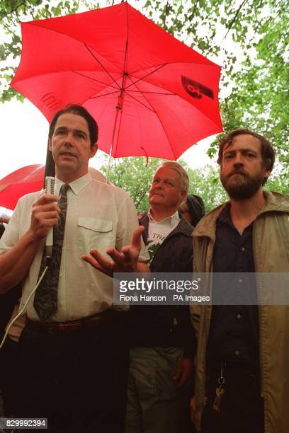 ACCOMPANIED BY BRUCE KENT AND JEREMY CORBYN MP ADRESSES A 'WALK FOR THE EARTH' RALLY OUTSIDE THE AMERICAN EMBASSY IN LONDON