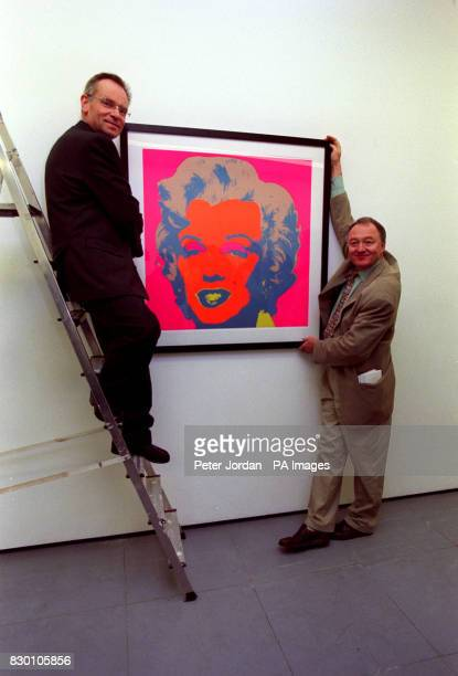 AND JEFFREY ARCHER WITH A MARILYN MONROE PICTURE BY ANDY WARHOL AT THE LAUNCH OF THE HACKNEY EMPIRE'S NEW APPEAL CAMPAIGN AT THE LUX CENTRE IN LONDON