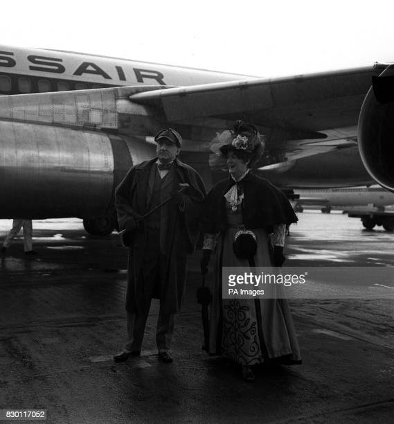 S DIPLOMATIC SERVICE DRESSED AS SHERLOCK HOLMES AT HEATHROW AIRPORT WITH HIM IS LADY GOREBOOTH DRESSED AS IRENE ADLER THEY WERE LEAVING FOR AN EIGHT...