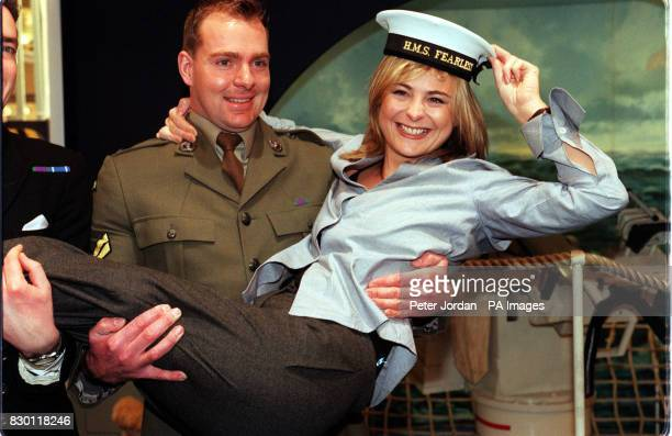 OF 'TOMORROW'S WORLD' IN THE ARMS OF A MEMBER OF HM ARMED FORCES AT THE LONDON INTERNATIONAL BOAT SHOW IN EARLS COURT THE DAY BEFORE THE SHOW OPENED...