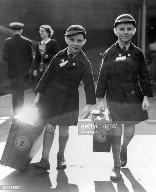 AND KEVIN JAMES SULLIVAN FROM ISLINGTON LONDON CARRYING THEIR LUGGAGE TO THE BOAT TRAIN 'RANGITOTO' AS THEY LEFT LIVERPOOL STREET STATION IN LONDON...