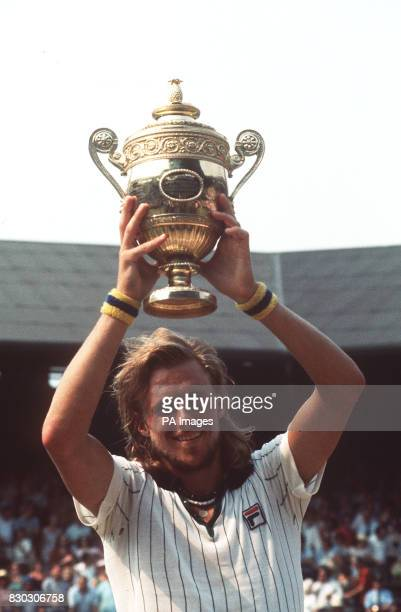 S BJORN BORG HOLDS ALOFT THE CHALLENGE CUP AT WIMBLEDON THIS AFTERNOON AFTER HIS STRAIGHT SETS VICTORY OVER ILIE NASTASE OF ROMANIA IN THE FINAL OF...