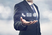 Businessman holding ( mail,phone,email ) icon. cutomer support concept