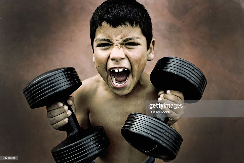 BOY WITH DUMBELL : Stock Photo