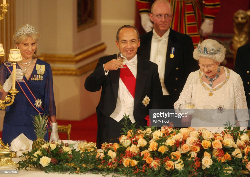 Mexico's President Felipe Calderon (C) and Queen Elizabeth II (R) raise their glasses during a state banquet hosted by the Queen in honour of the visiting president and first lady, inside the Ballroom at Buckingham Palace on March 30, 2009 in London, England. President of the United Mexican States Felipe Calderon and his wife Margarita Zavala de Calderon are on a four-day state visit to the United Kingdom from March 30 - April 2.