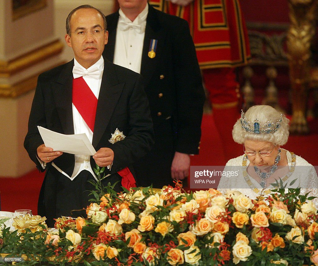 Mexico's President Felipe Calderon (L) speaks beside Queen Elizabeth II during a state banquet hosted by the Queen in honour of the visiting president and first lady, inside the Ballroom at Buckingham Palace on March 30, 2009 in London, England. President of the United Mexican States Felipe Calderon and his wife Margarita Zavala de Calderon are on a four-day state visit to the United Kingdom from March 30 - April 2.