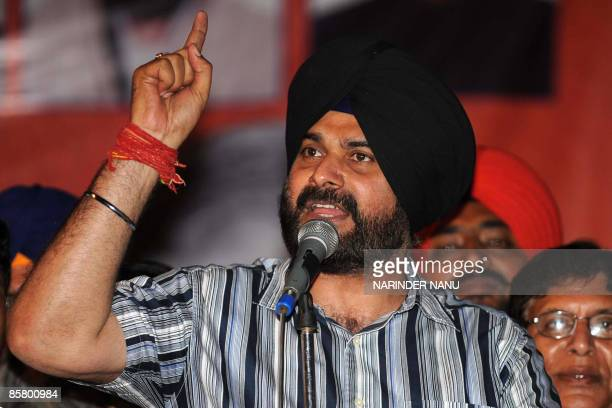 Indian cricketer turned politician and sitting Member of Parliament of Bharatiya Janata Party Navjot Singh Sidhu addresses supporters during an...