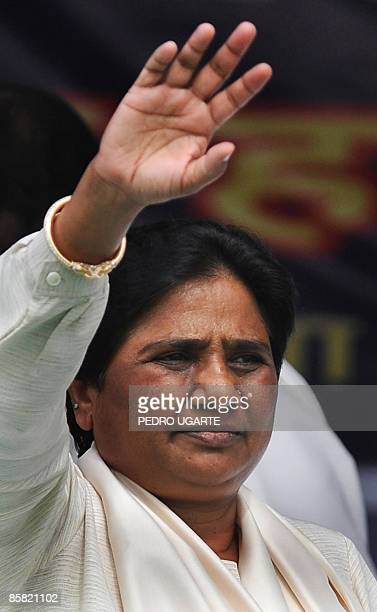 Bahujan Samaj Party President and Chief Minister of Uttar Pradesh state Mayawati Kumari waves as she arrives at a political rally in Nuh some 100 kms...
