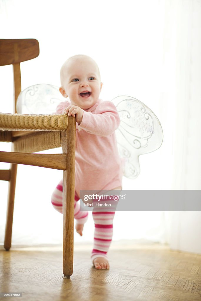 BABY WEARING BUTTERFLY WINGS : Stock Photo