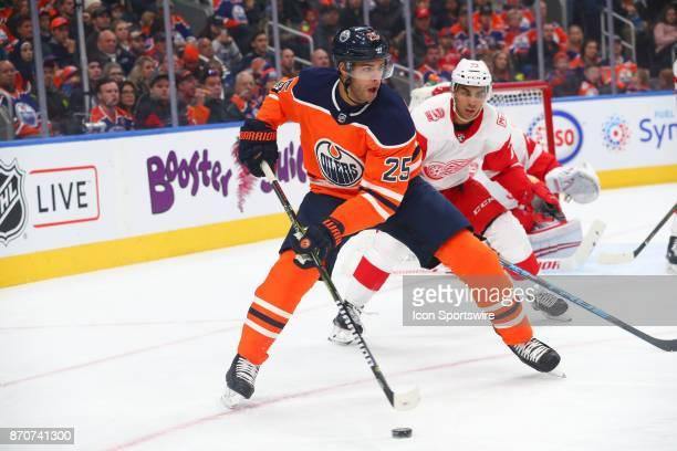 Edmonton Oilers Defenceman Darnell Nurse protects the puck in the first period against Detroit Red Wings Winger Andreas Athanasiou during the...