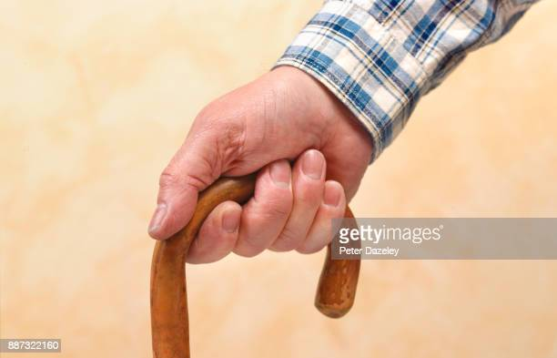 OLD AGE PENSIONER WITH WALKING STICK