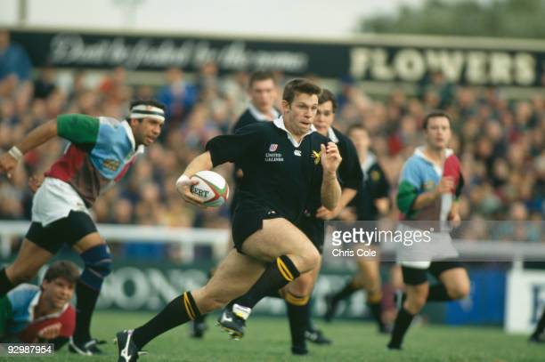 English rugby union player Damian Hopley of the London Wasps breaks through to score against the Harlequins 17th September 1994 The final score was...