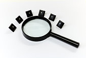 A magnifying glass searching for keywords.