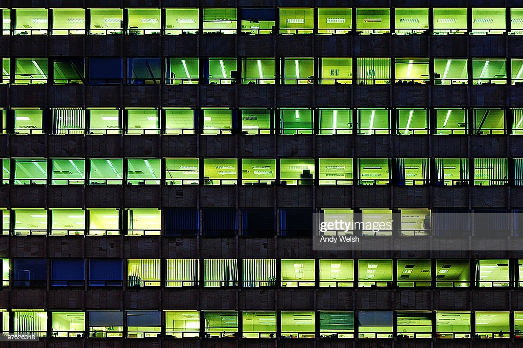 NIGHT OFFICE BLOCKBUSTER : Stock Photo