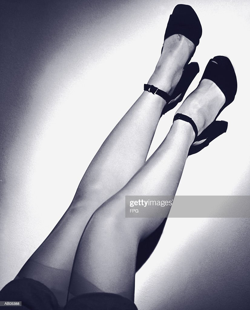 WOMAN'S LEGS, IN STOCKINGS & SHOES WITH ANKLE STRAPS : Stock Photo