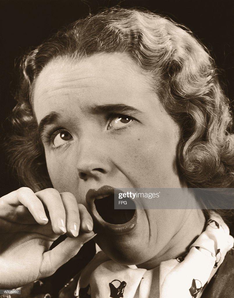 HEADSHOT / WOMAN YAWNING : Stock Photo