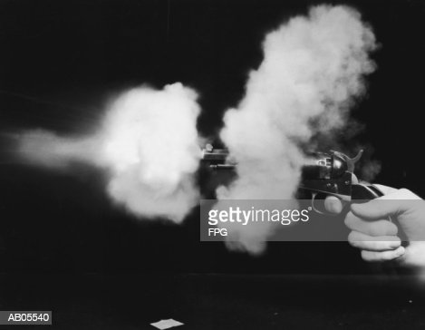 CLOSE-UP / GUN BEING FIRED : Stock Photo