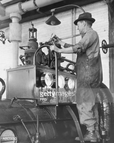 MAN OILING MACHINE : Stock Photo