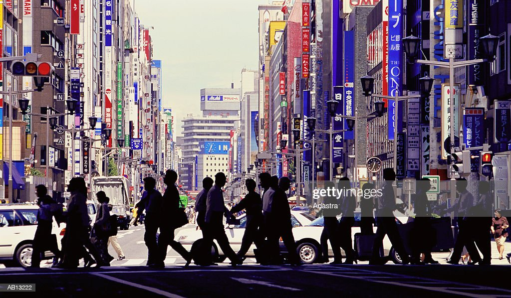PEDESTRIANS CROSSING STREET IN GINZA DISTRICT OF TOKYO, JAPAN : Stock Photo