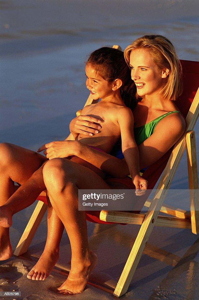MUM AND DAUGHTER ON BEACH : Stock Photo