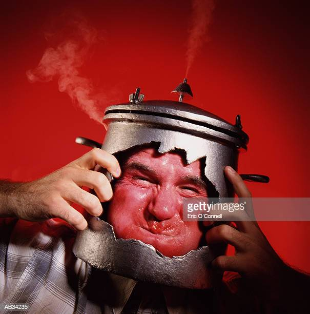 MAN WITH HEAD IN PRESSURE