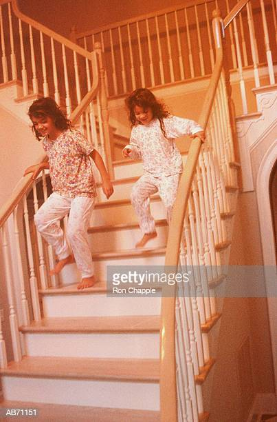 2 GIRLS IN PAJAMAS ON STAIRS