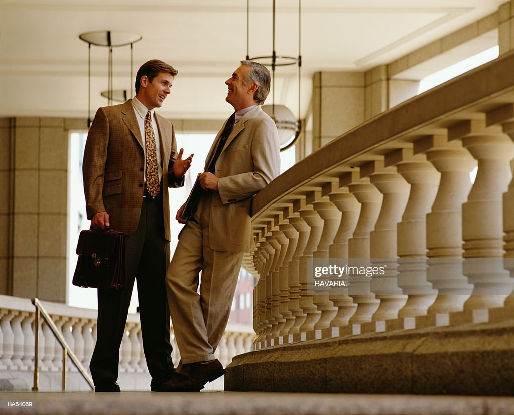 TWO BUSINESSMEN HAVING A CHAT : Stock Photo