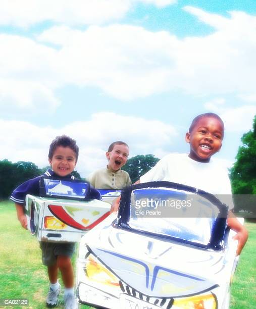 MULTI ETHNIC BOYS IN TOY BOXCARS