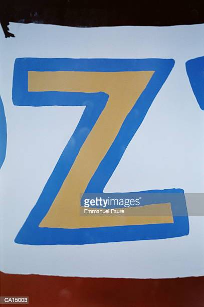 CLOSE-UP / BLUE & YELLOW LETTER 'Z' ON WHITE BACKGROUND