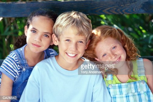 BOY AND GIRLS IN TREEHOUSE PORTRAIT : Stock Photo