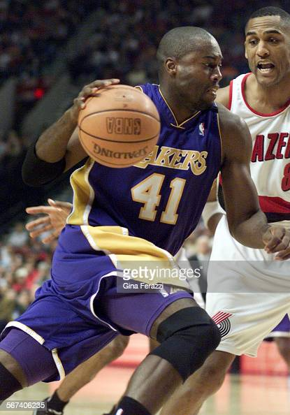 SP0526lakers16GF–Laker Glen Rice drives to the basket against Trail Blazer Steve Smith in Game 4 of the Western Conference Finals at the Rose Garden...