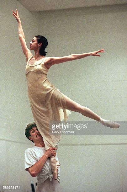 CA0525nina9gf Ballerina Nina Ananiashvili is lifted by her Bolshoi Ballet dance partner Andrei Uvarov during a rehearsal on 5/28/00 at the Kennedy...