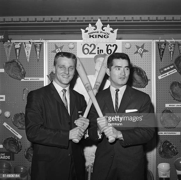 Home run king Roger Maris of the New York Yankees demonstrates his batting grip for the Japanese homer champ Shigeo Nagashima as the two met at the...