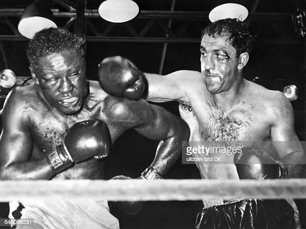 *Sportler Boxer USAim Kampf gegen Ezzard Charles im YankeeStadion New York