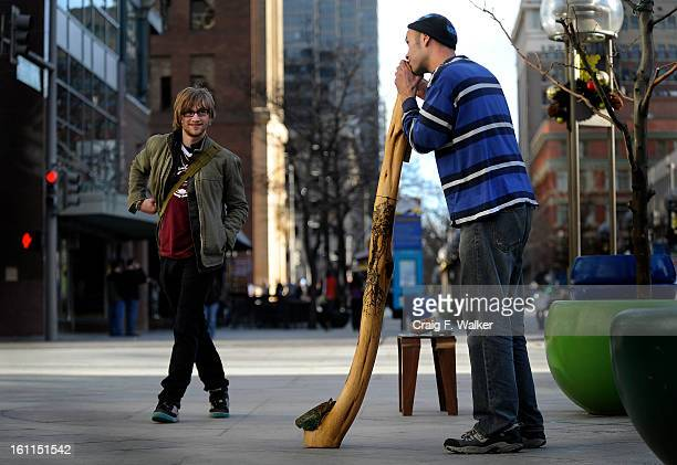 011310_Adam Fehlberg entertains pedestrians with his 'nontraditional' Didgeridoo on the 16th Street Mall in Denver CO He says the instrument is the...