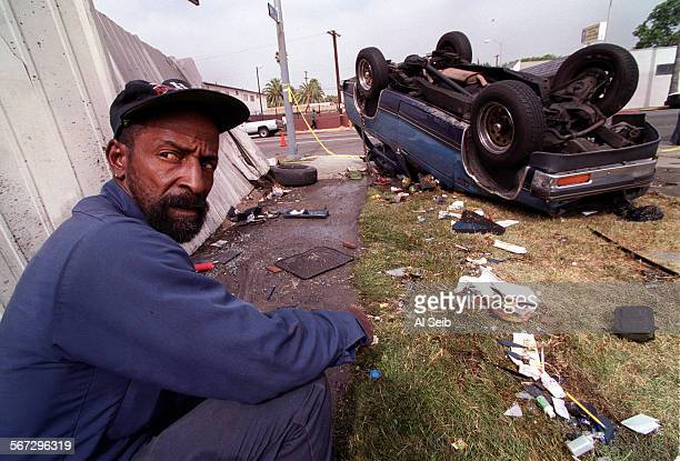 ME0705assault1AS Larry Scott owner of Fronteer Auto Repair at corner of 80th Ave and Avalon in South Central LA witnessed a two car collision that...